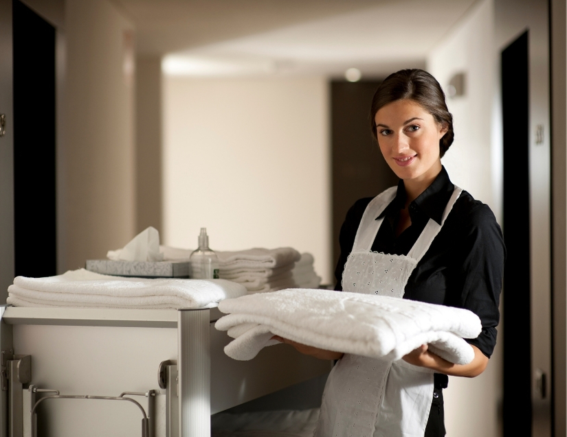 maid holding clean towels